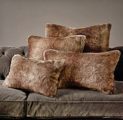 Faux fur pillows on a couch.