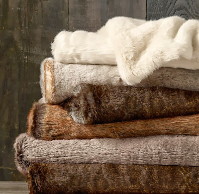 Faux fur blankets folded in a stack.