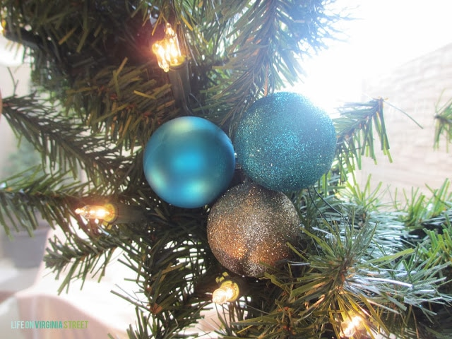 The three ornaments on the the wreath.