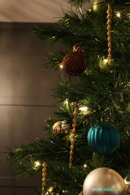 Blue and gold ornaments are on the tree.