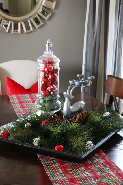 A small tray holds ornaments and a deer.