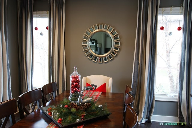 There are ornaments on the windows in the dining room.