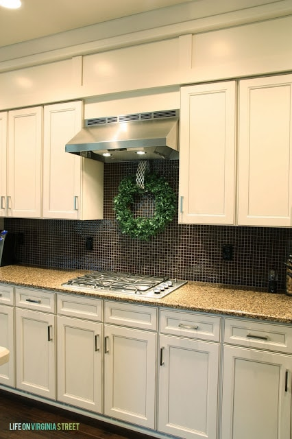 A boxwood wreath hangs in the kitchen.