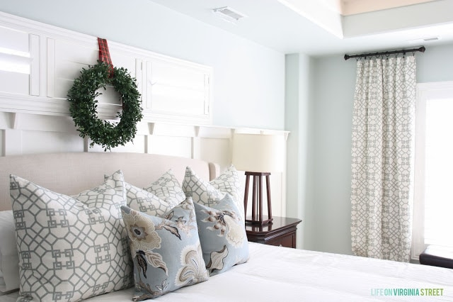 There are powder blue pillows on the bed.