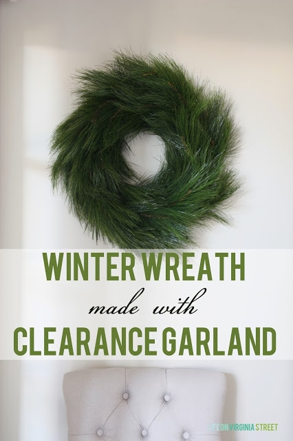 DIY Winter Wreath made from Clearance Garland with a white chair underneath it.