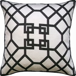 A small brown and white pillow.