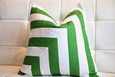 White and green striped pillow on the couch.