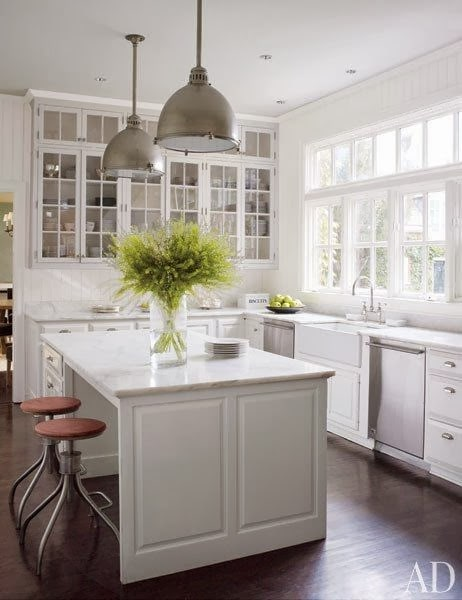 White kitchen with silver pendants