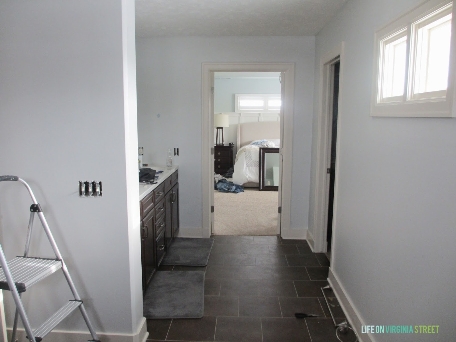 the color is somewhat reminiscent of the paint in our last bathroom behr light french gray but this has less blue in it and i believe this will look even