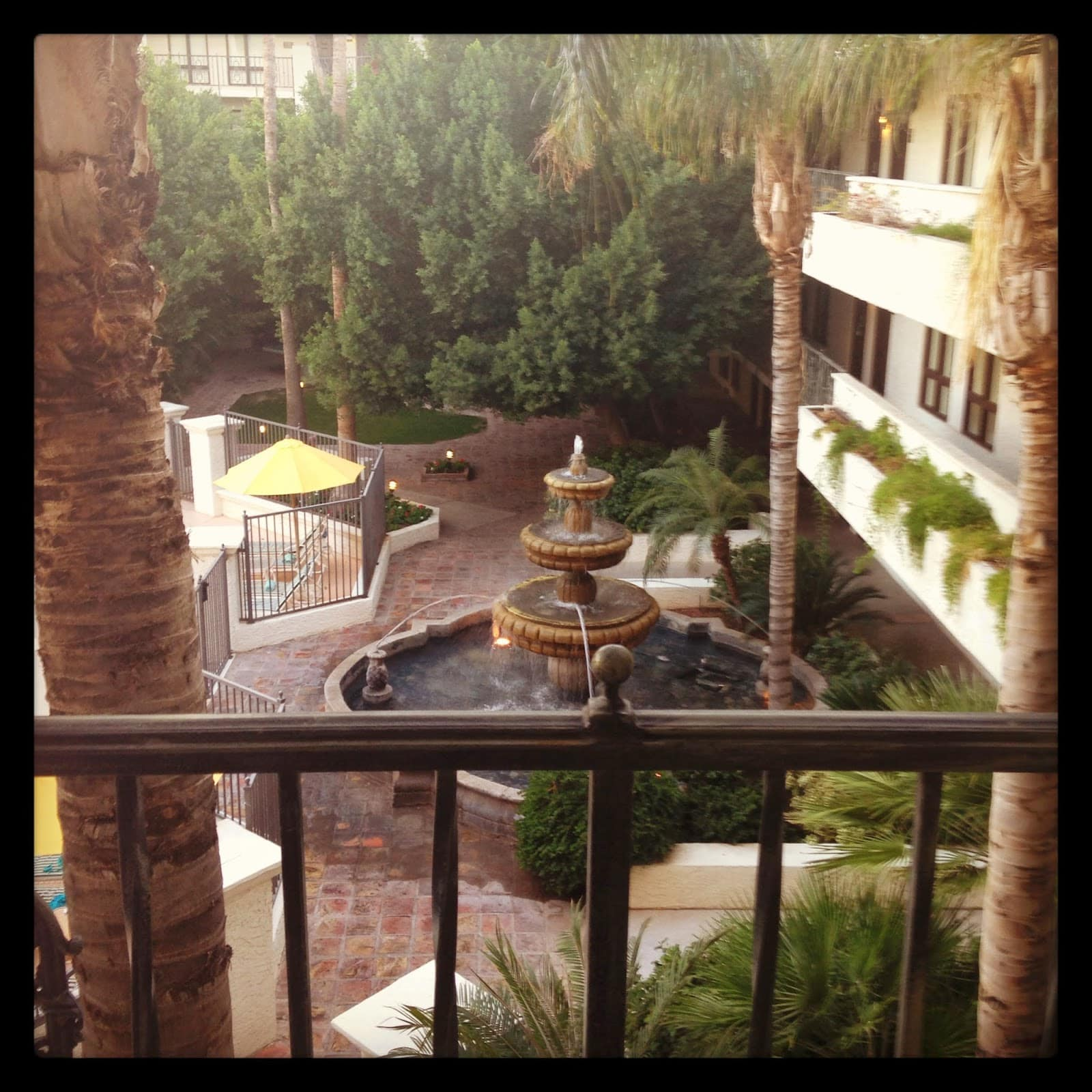 The courtyard of the hotel with a fountain in the middle.