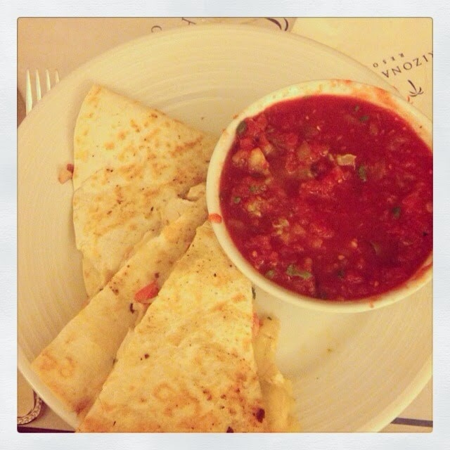 Chips and salsa on a plate.
