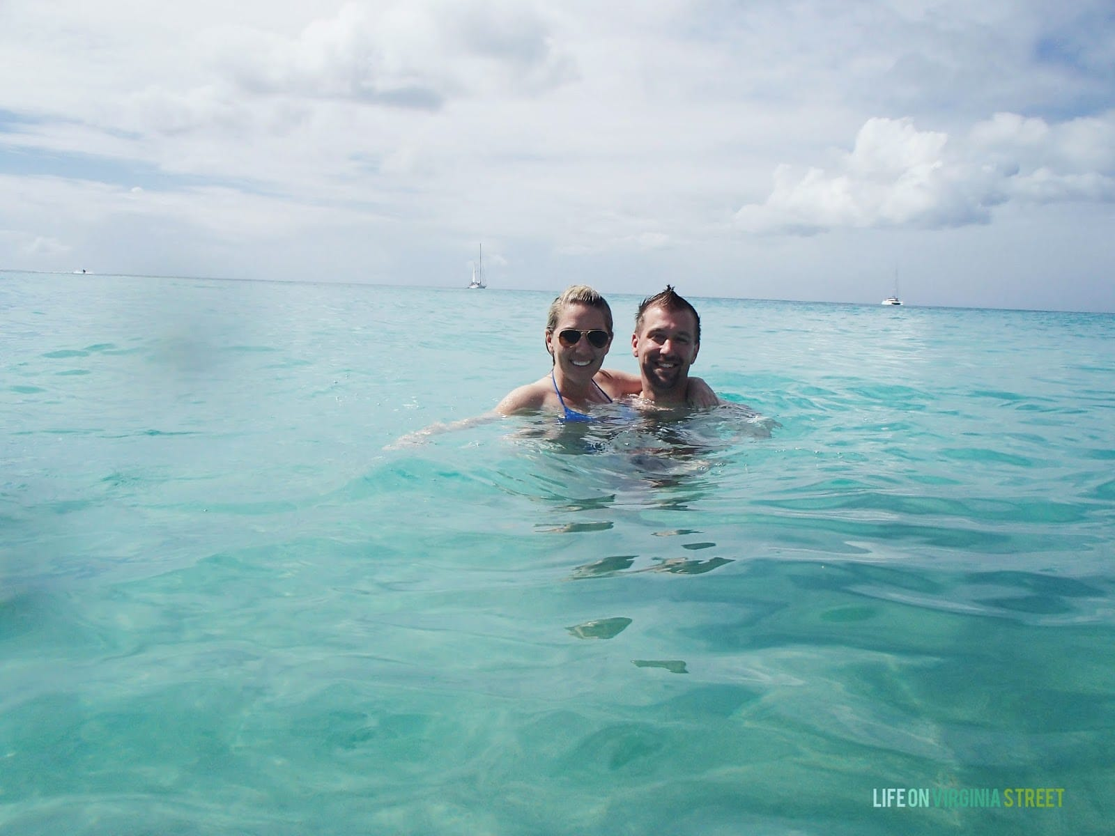 A couple swimming in the ocean.