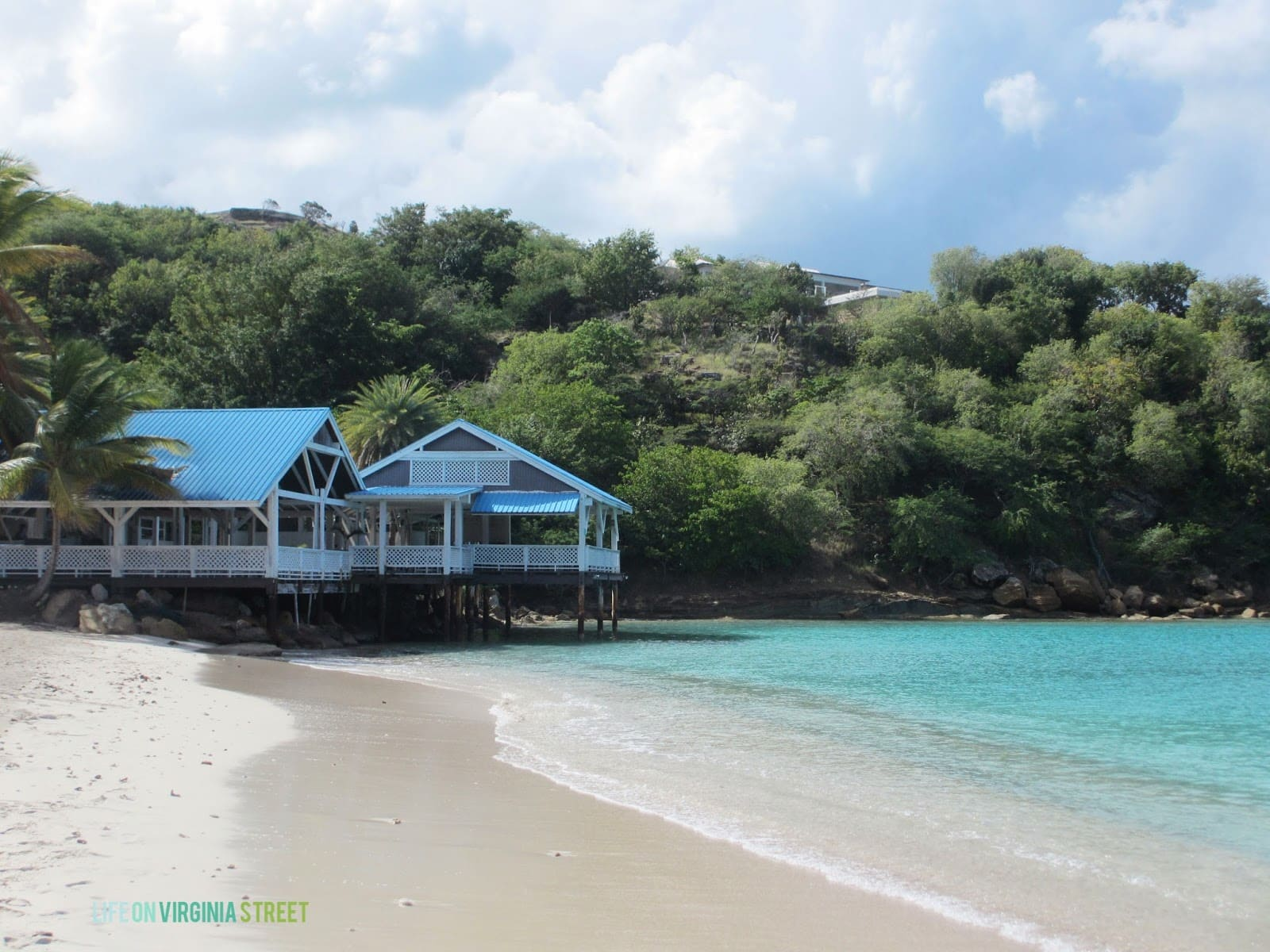 A house on stilts by the shore in the Caribbean.