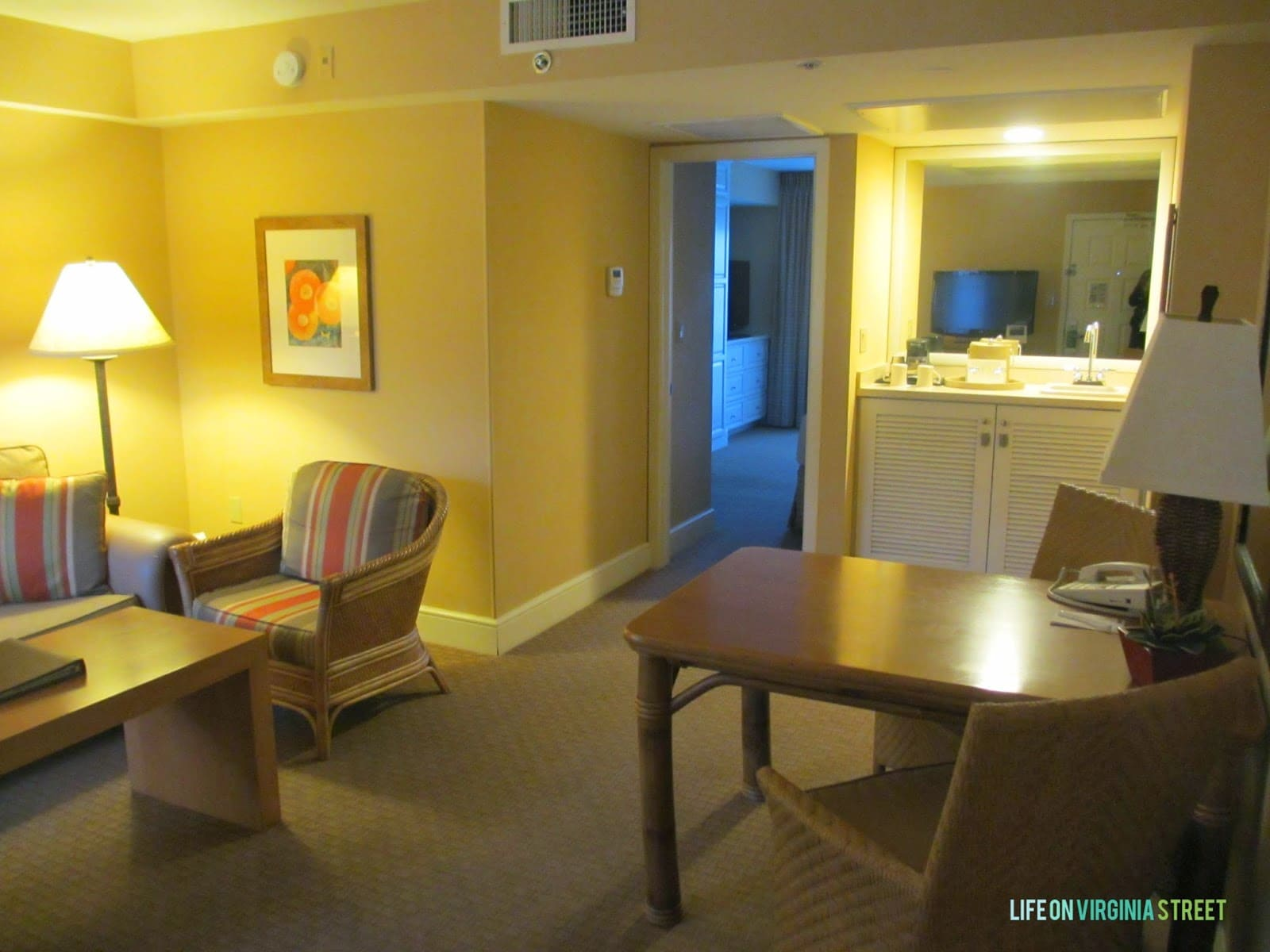 A small desk inside the hotel room.