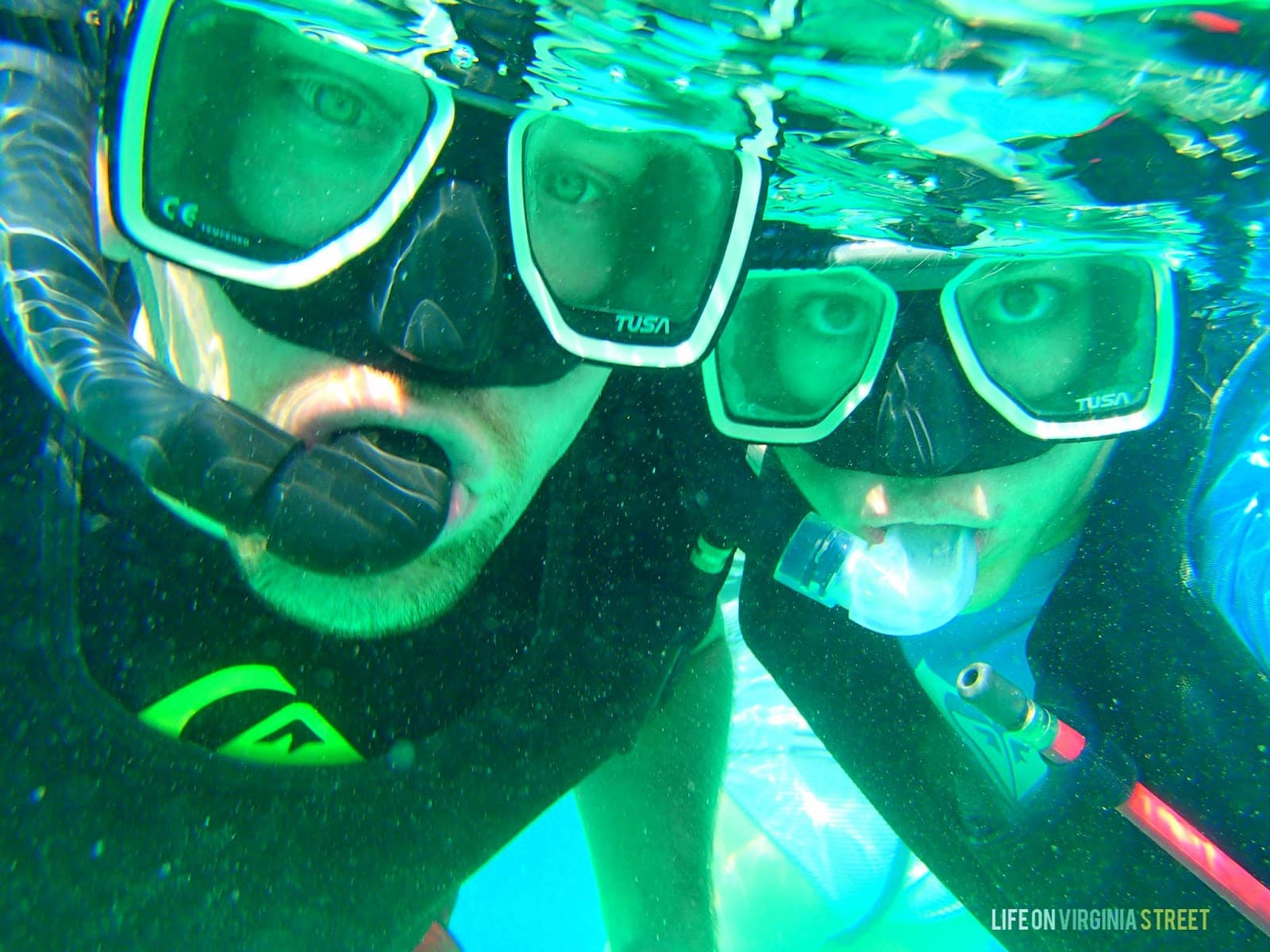 A man and woman snorkelling.