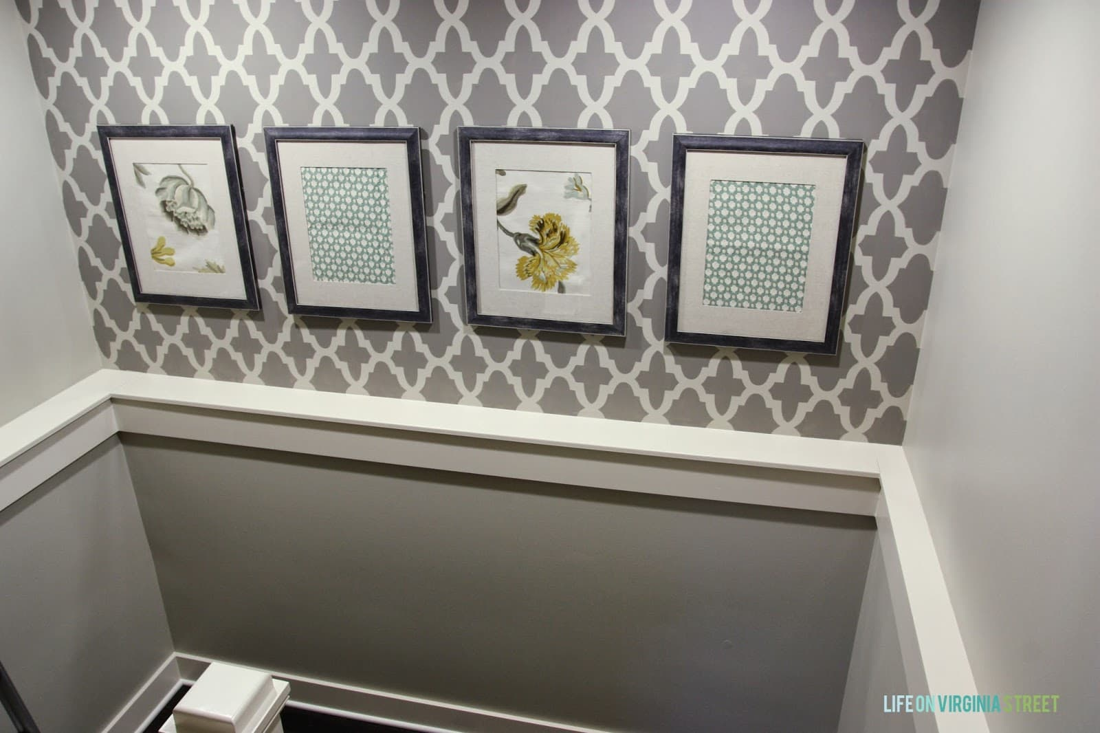 The grey and white stencilled wall.