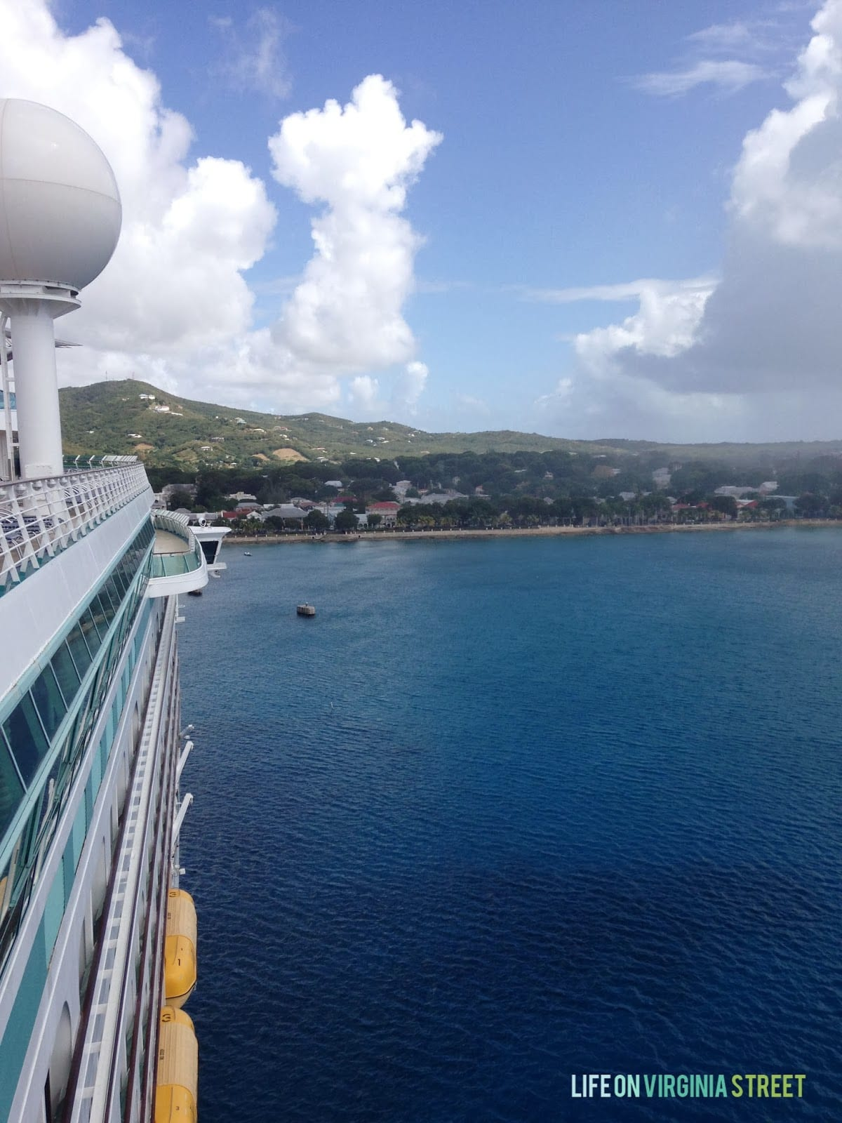 On the cruise ship looking at the shore.