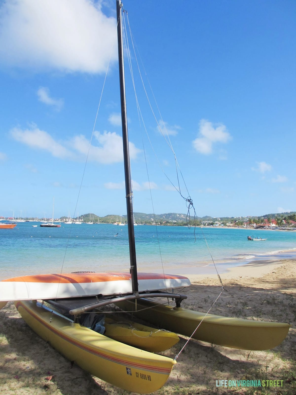 A catamaran on the beach in the Caribbean.