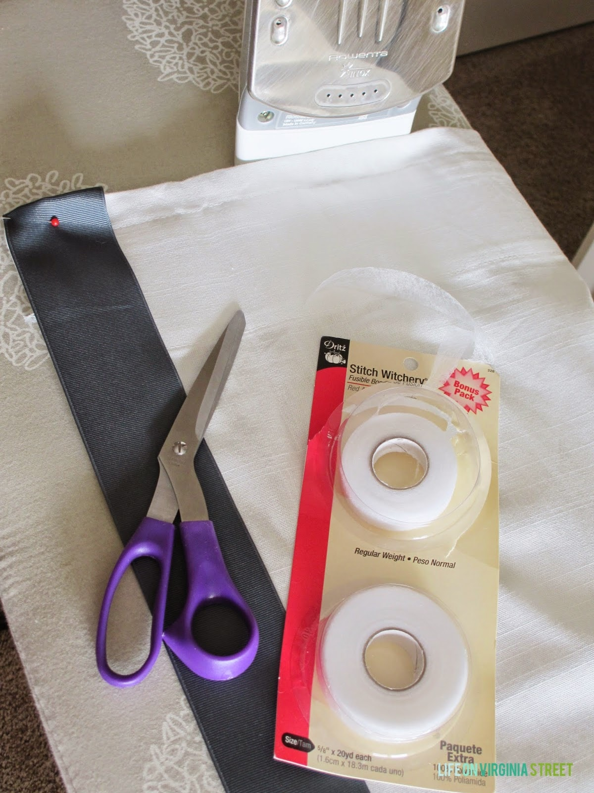 Fabric, scissors, stitch tape on the counter.