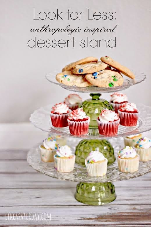 Dessert stand with cupcakes and cookies on it.