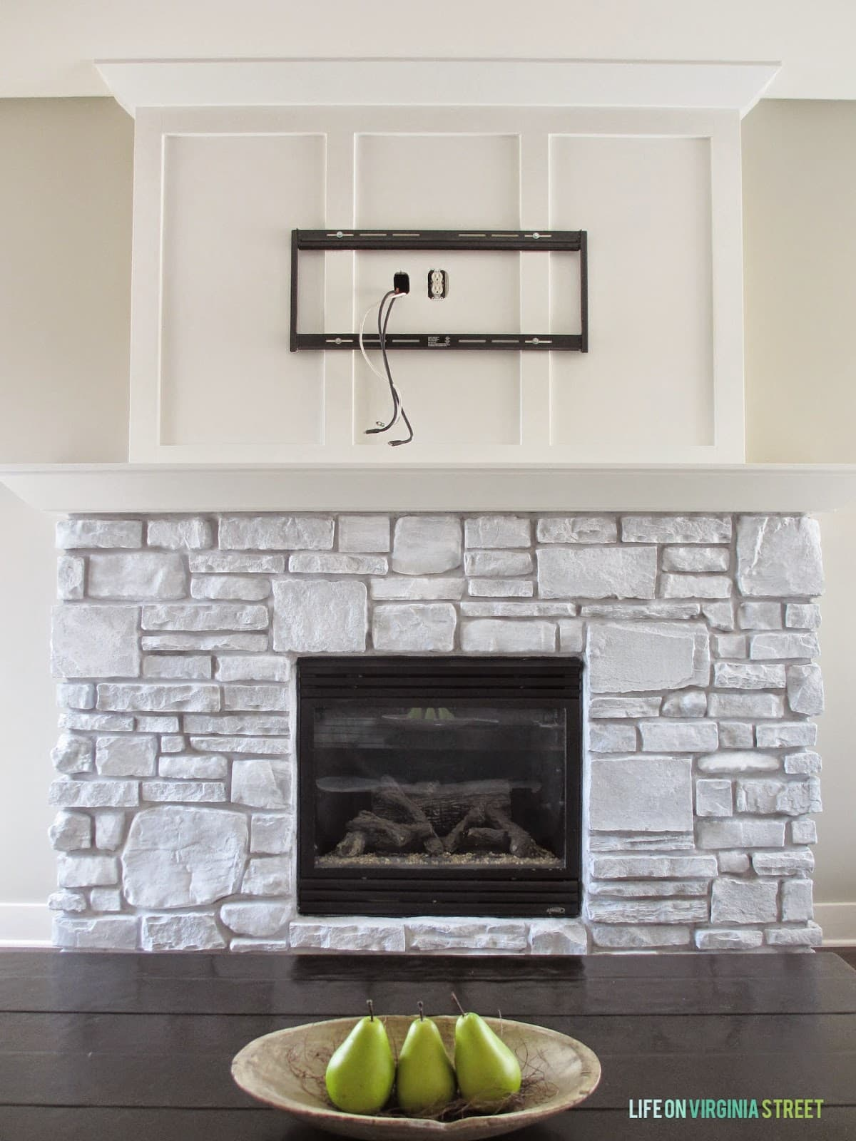 Whitewashed stone fireplace makeover and reveal.