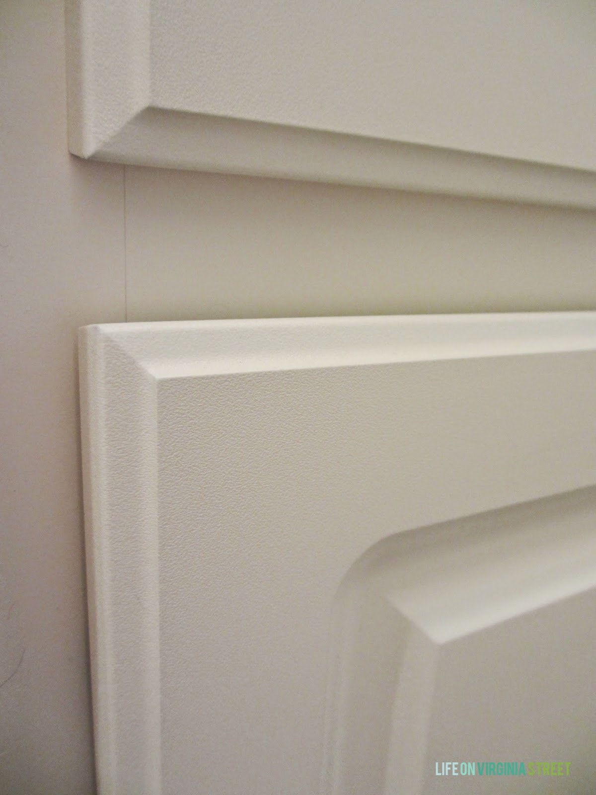 Close up of the cream white laminate bathroom cabinets I'm planning to paint.