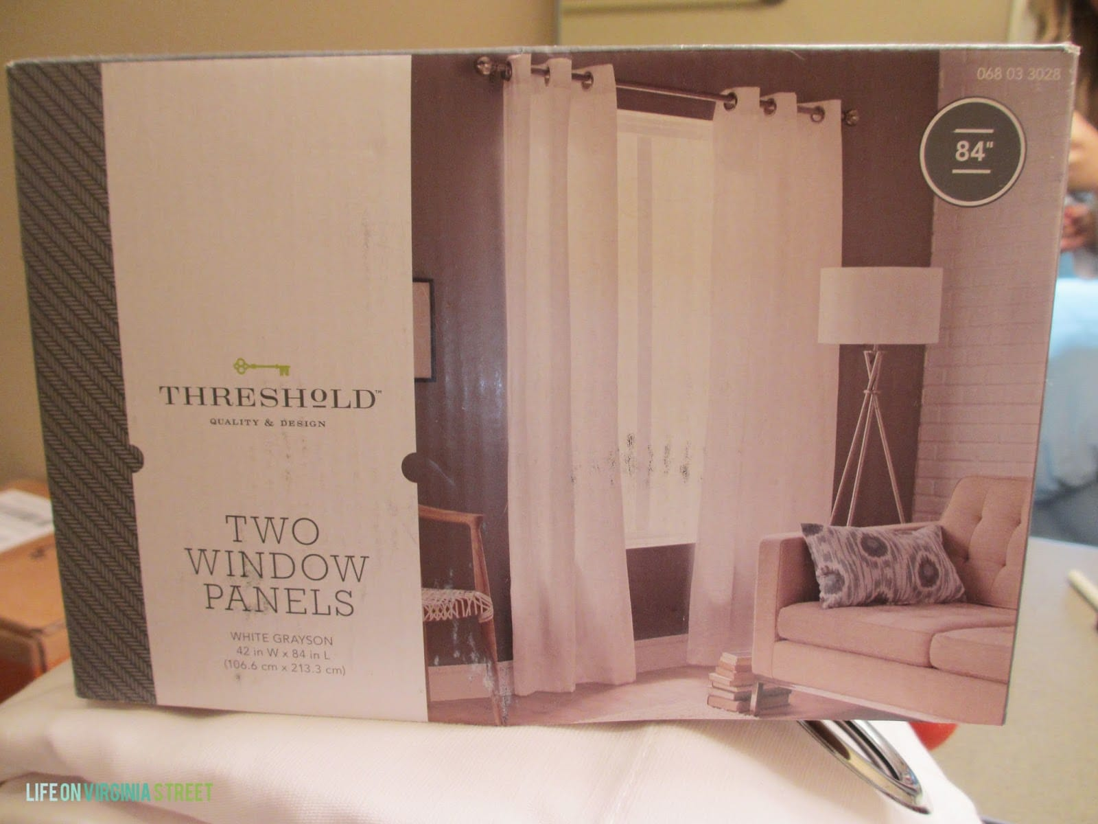 Plain white window panel curtain from target to use for my bathroom shower curtain makeover.