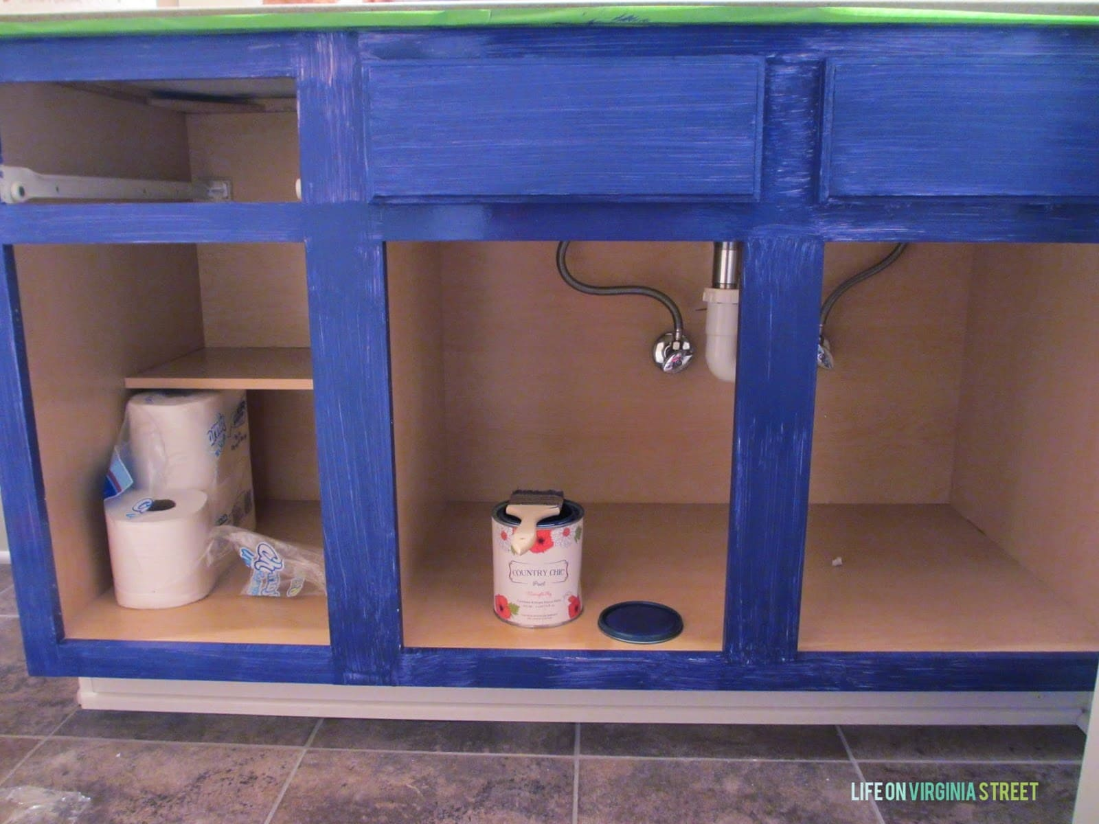 Blue cabinets partway through painting. This is one coat.