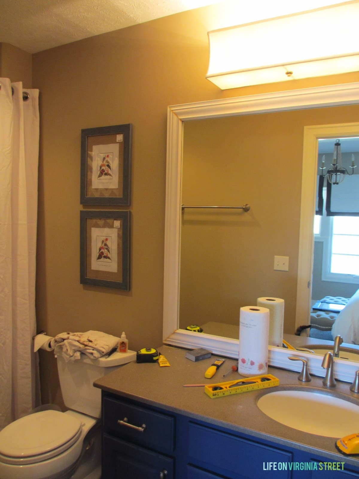 Bathroom Makeover Kit guest bathroom: lighting and framing a builder-grade mirror