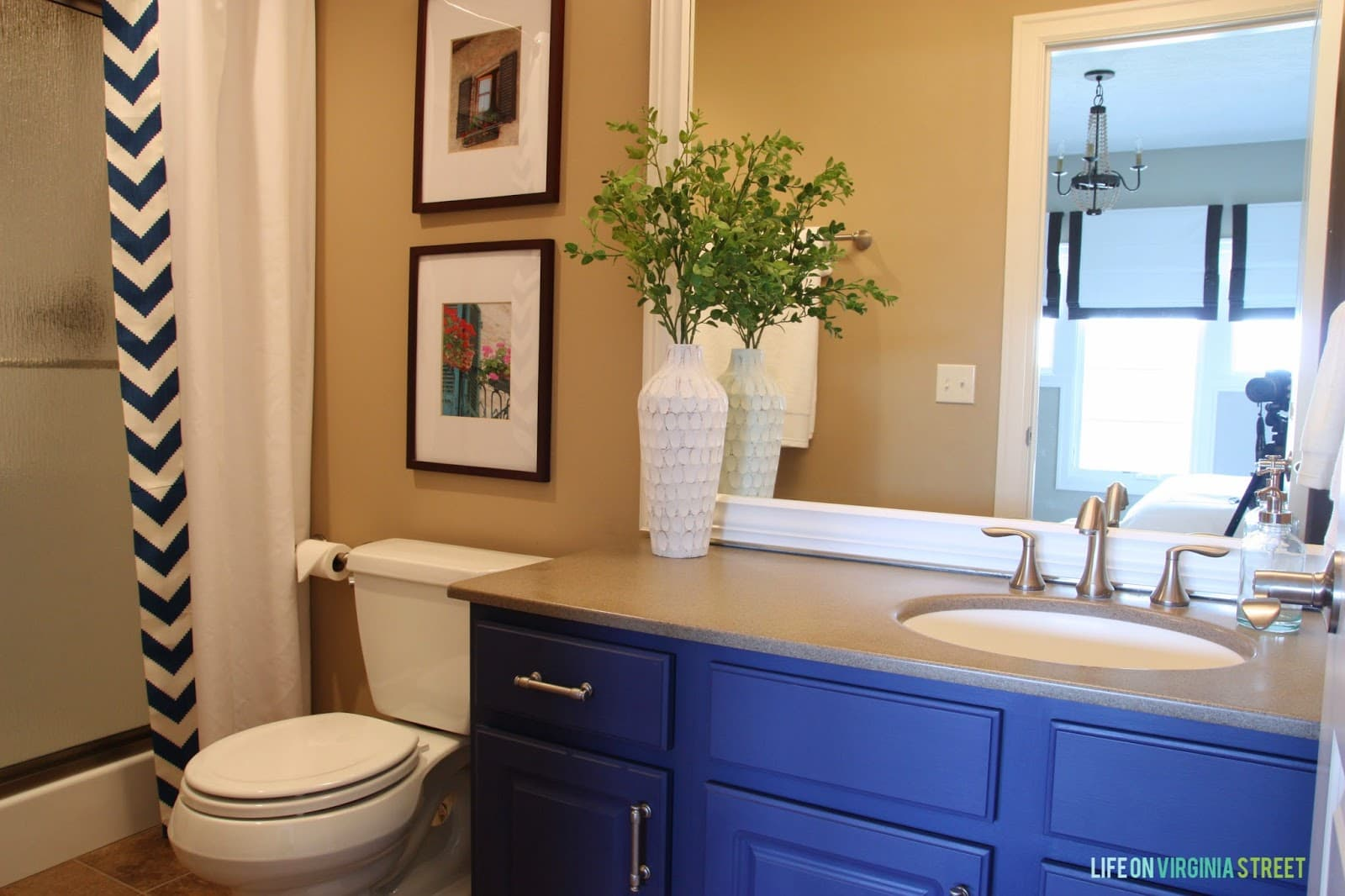 Here's the finished look of our new bold bathroom! I love the blue vanity and the DIY no sew shower curtain.
