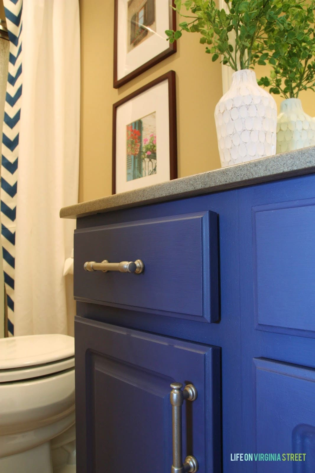 Painted laminate bathroom cabinets in bold blue.