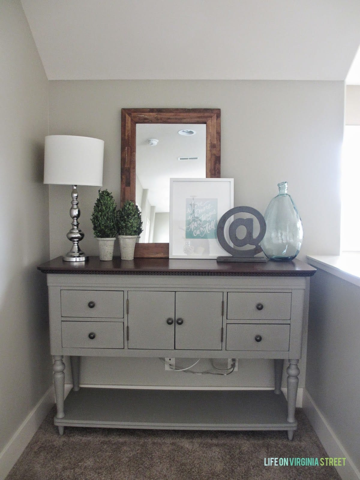 We used this painted buffet table to hide our wi-fi setup and add a little something extra to the upstairs hallway makeover.