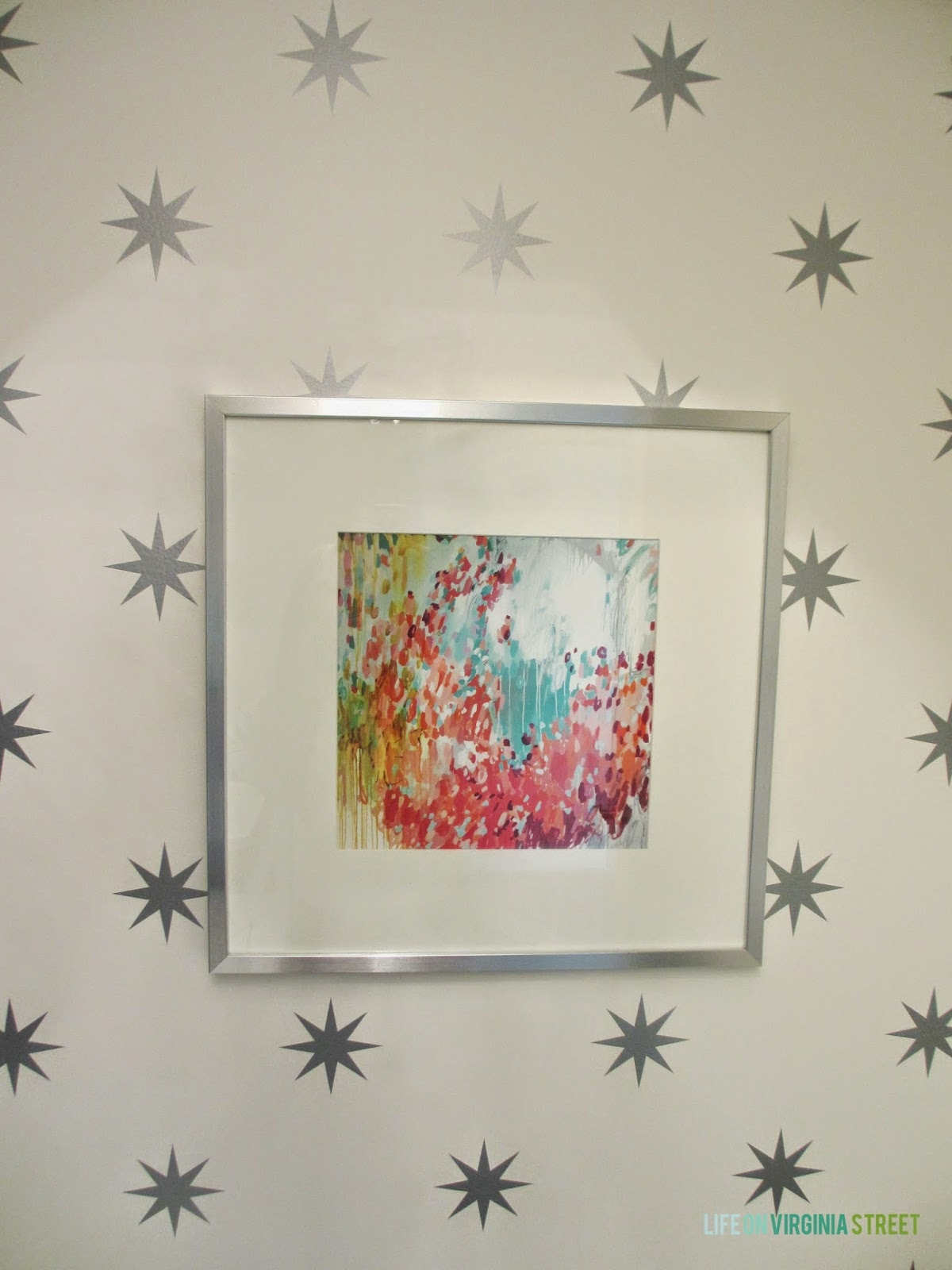 Michelle Armas print in a bright laundry room