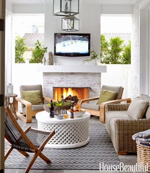 This outdoor patio has a similar theme - creating a fireplace wall to block the neighbor's view!