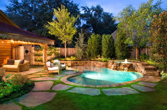 This one also has a pool with rounded edges and the grass and stones mixed together.