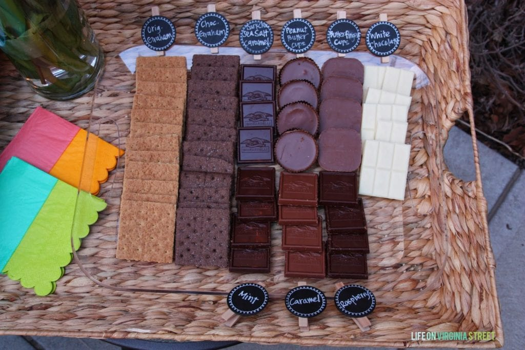 The different types of chocolate and wafers in a tray on the patio.