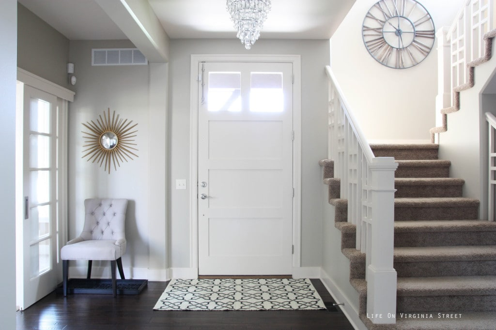Light and bright ntryway with Behr Castle Path walls and Behr Elephant Skin Door.