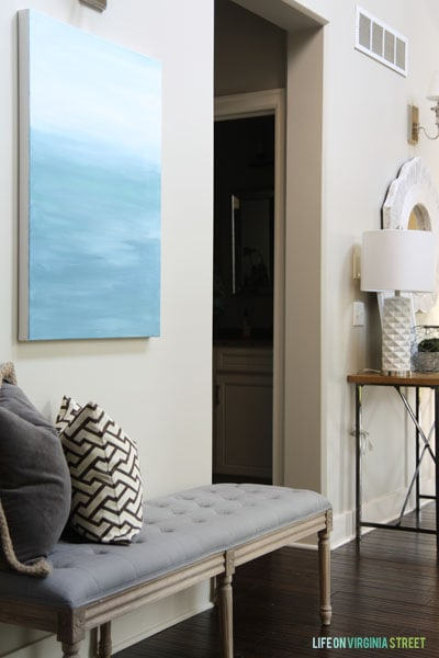 Entryway with bench and DIY canvas art.