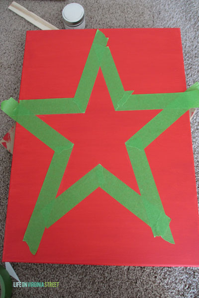 The outline of the star in green tape.