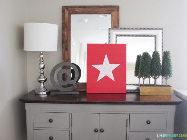 The white star on a red background on the side table.