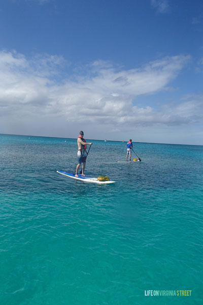 {My brother & husband paddle boarding in Turks & Caicos}