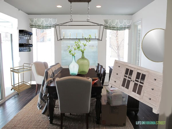 dining room with shades and buffet and mirror