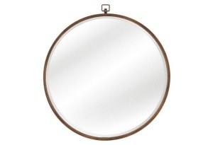 This simple round mirror looks elegant on any wall with a modern touch.