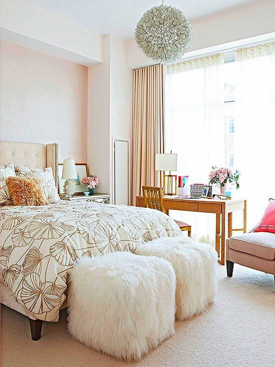 Pale pink blush walls are sweet and cozy in a gorgeous bedroom,.