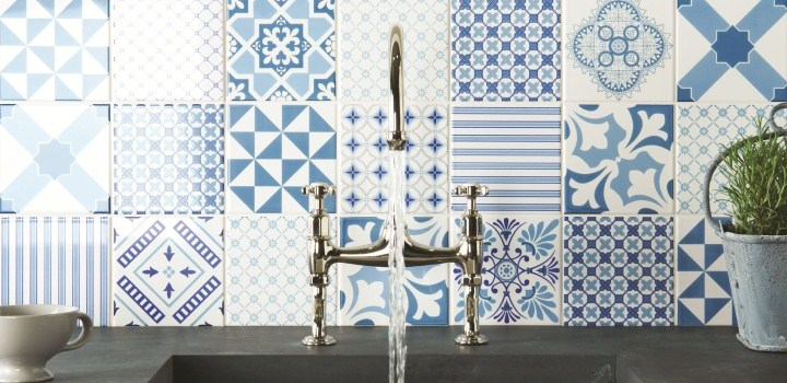 blue and white concrete tile kitchen backsplash with silver faucet.