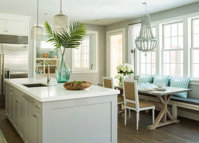 Decorating with Palm Fronds in the kitchen on the white kitchen island.