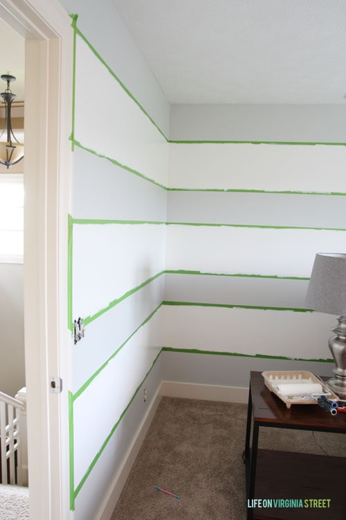 How To Achieve Perfectly Striped Walls - Details on How to Paint and a photo of my progress. This is after the first coat of paint went on. - Life on Virginia Street