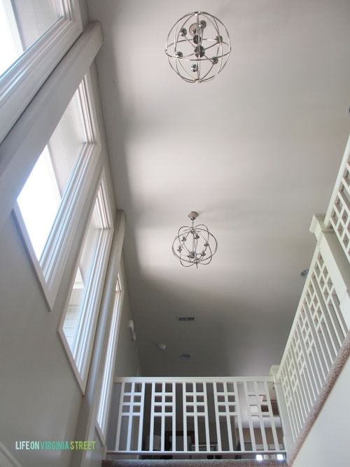 Entryway Lights - here's a great shot from the first floor looking up at our new hallway orb lights. I love the look! - Life On Virginia Street