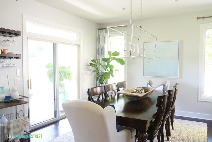 The Behr Silver Drop paint lightens up the Dining Room with a Darlana Linear Pendant Chandelier.