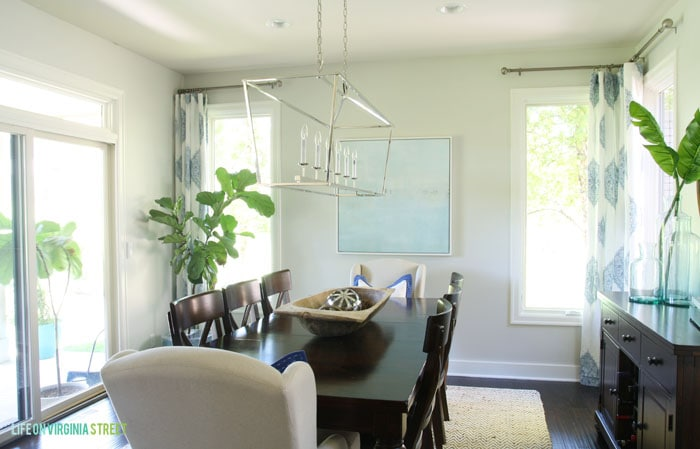 Stunning dining room makeover reveal using light, bright colors, whites and blues.